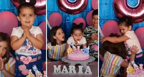 El famoso video que se ha vuelto viral por 2 niñas que soplan un pastel